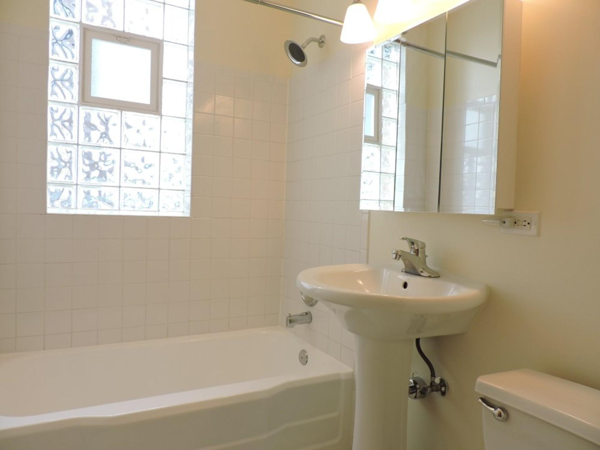 Sunny Two BR Deluxe Condo with SS Appliances, A/C, Parking, HEAT INCLUDED