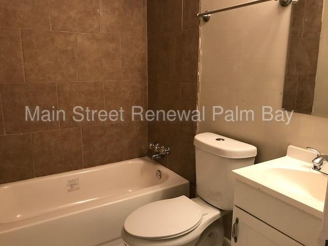 Beautiful Four BR Two BA ALL TILE home with lovely landscaping!
