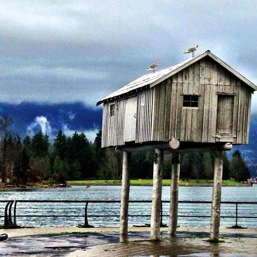 photo of Silver boat shed on stilts, seawall at 323 Jervis Street Vancouver BC Canada