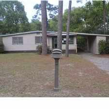Rental info for Beautiful original hardwood flooring throughout home! All white cabinets in kitchen. Breakfast area and separate dining room with crown molding. Laundry room, carport with a storage room, deck in the back that over looks the shady fenced in backyard.