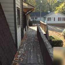 Rental info for Home is adorned with hardwood floors throughout. Washer/Dryer Hookups!