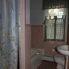 Rental info for Lovely brick home on a corner lot with fenced yard and hot tub. Washer/Dryer Hookups!