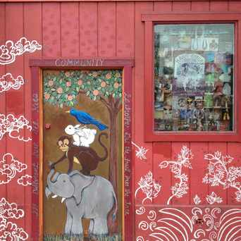 Photo of Painted Door Beside Tibetan Gift Cornet in Haight Ashbury, San Francisco